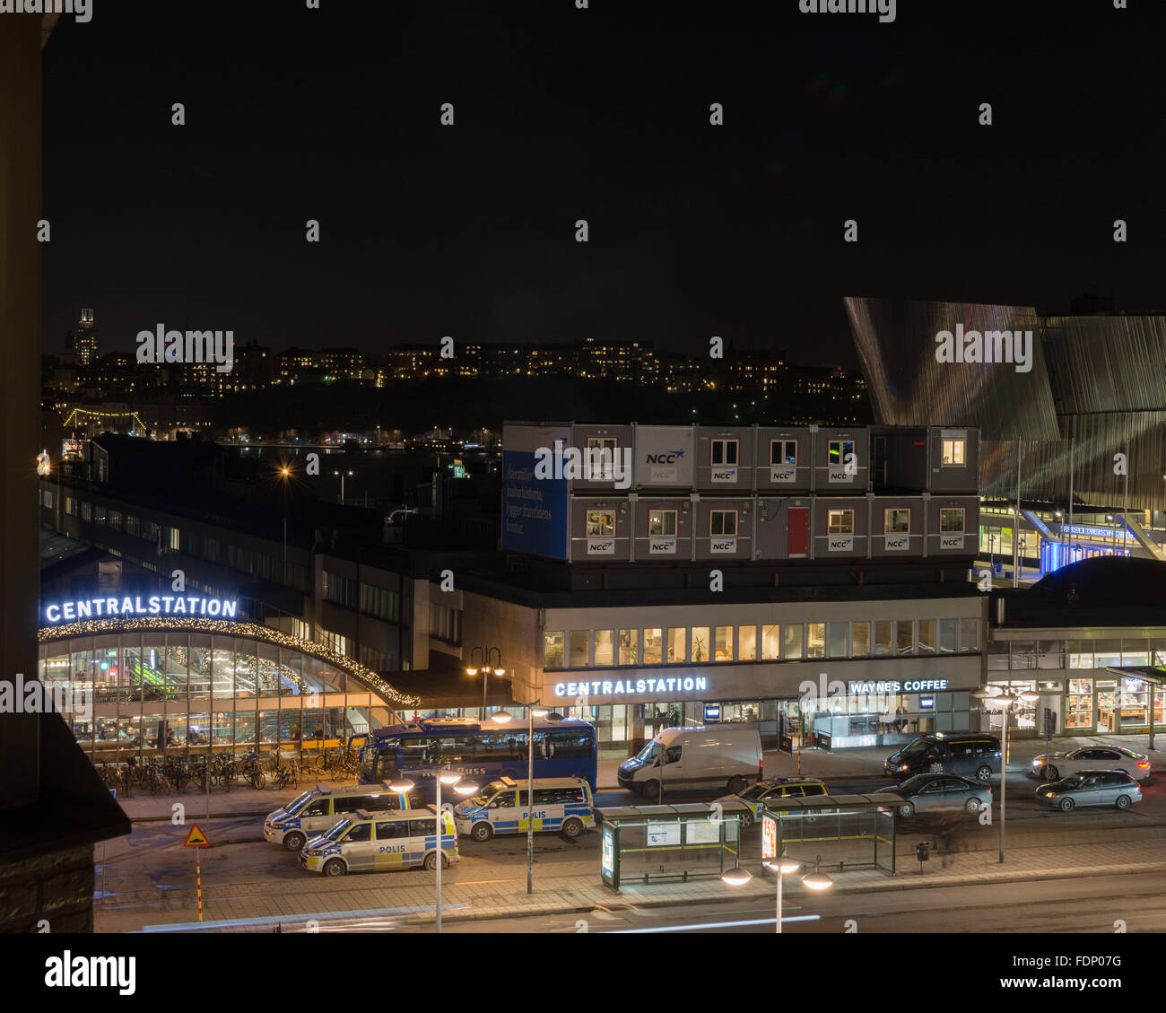 Police vans parked outside Central Station, Stockholm, Sweden - Stock Image
