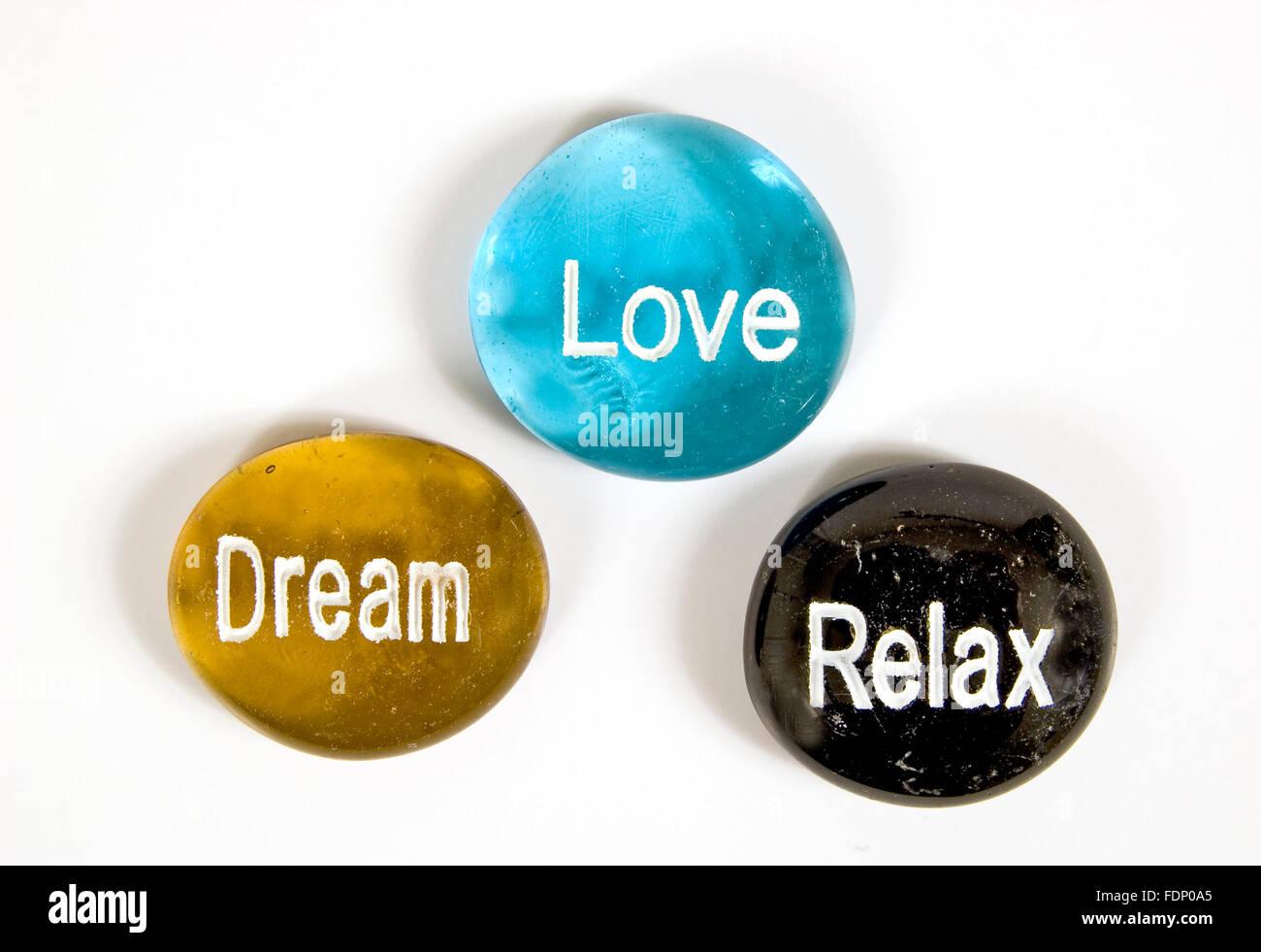 Dream Love Relax Encouragement Stones on White Background - Stock Image