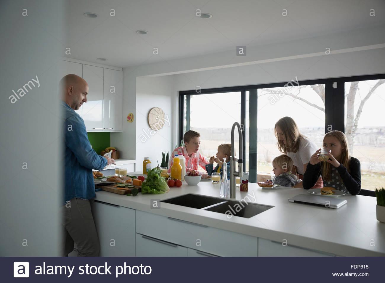Eating Kitchen Island Family eating at kitchen island stock photo 94530052 alamy family eating at kitchen island workwithnaturefo