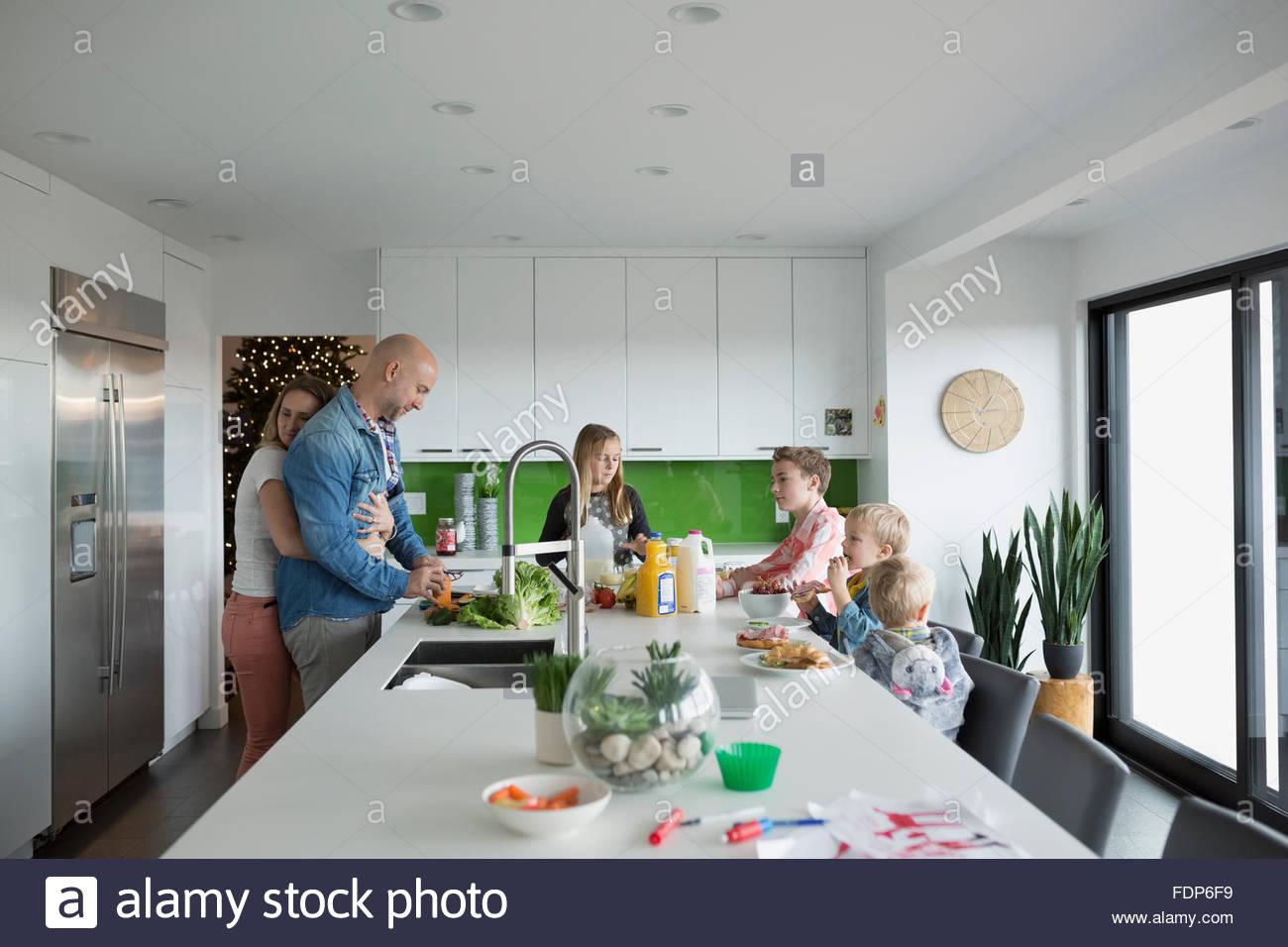 Eating Kitchen Island Family eating around kitchen island stock photo 94530445 alamy family eating around kitchen island workwithnaturefo