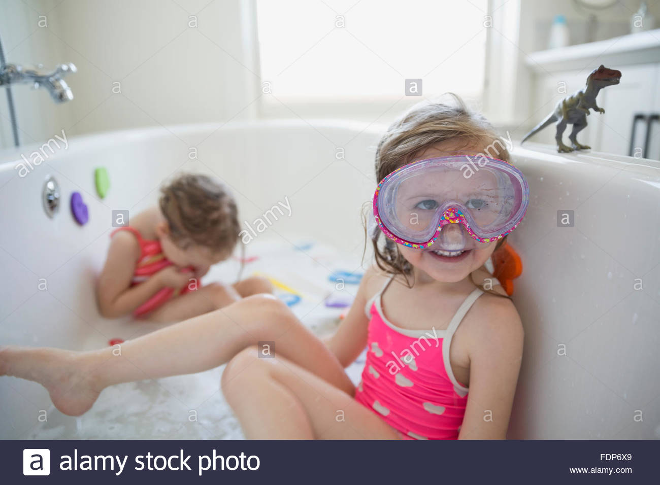 Girl bathing suit and goggles playing bath Stock Photo: 94530753 - Alamy