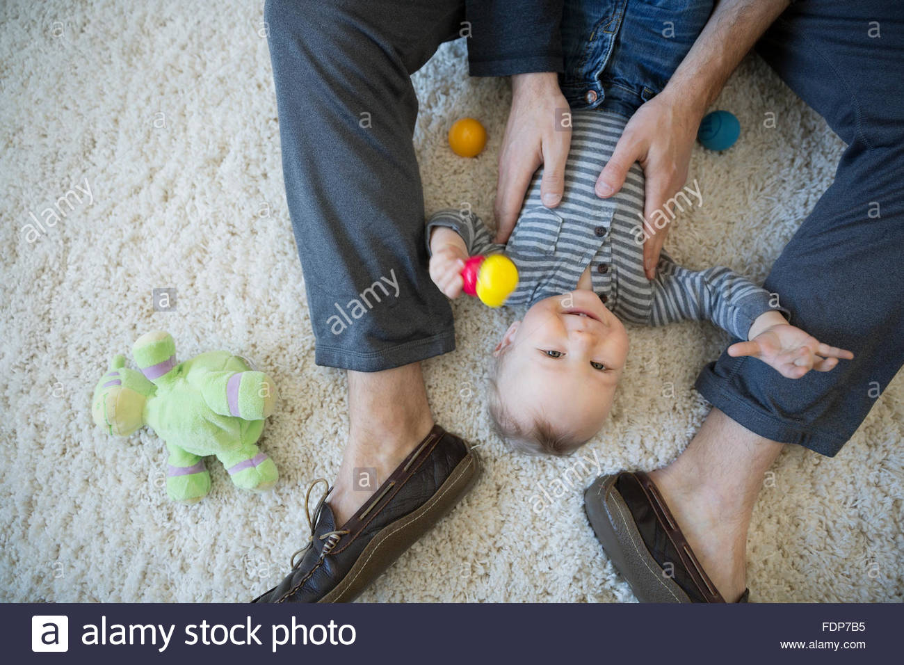 directly above baby son laying - Stock Image