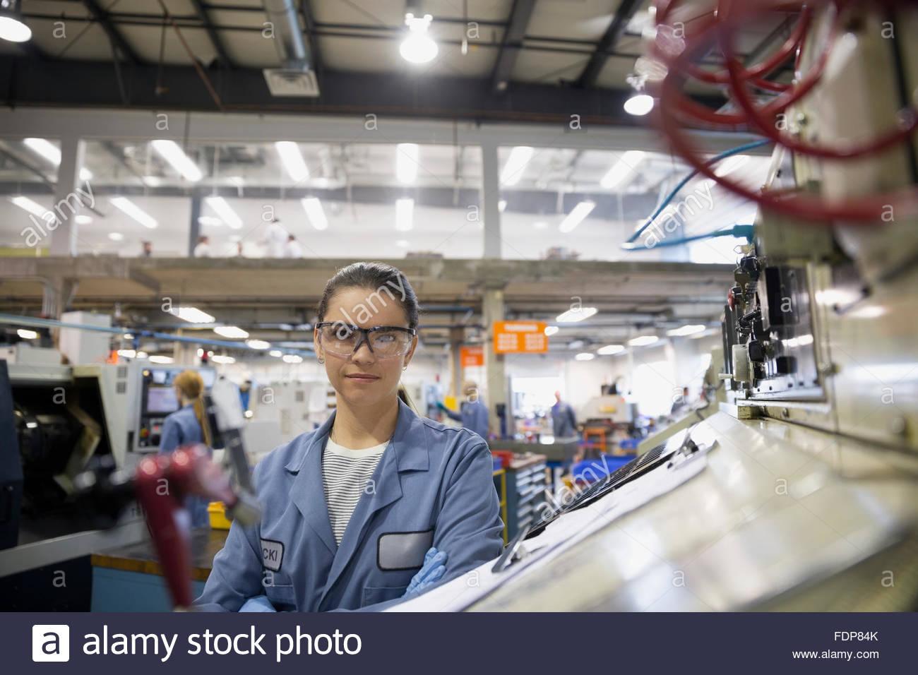 Portrait confident worker in textile factory - Stock Image