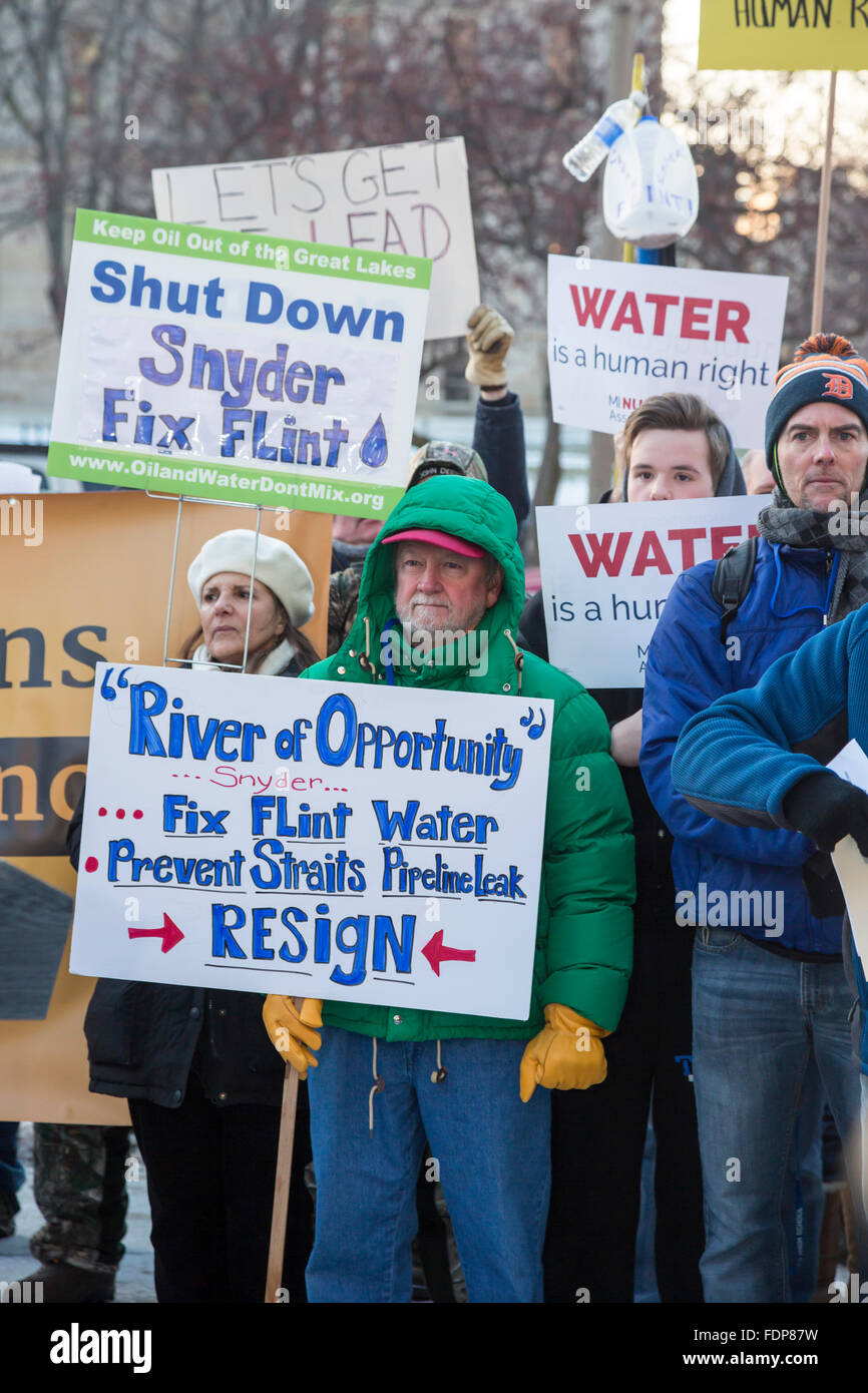 Lansing, Michigan - Protesters call for Michigan governor to resign over Flint water crisis. - Stock Image