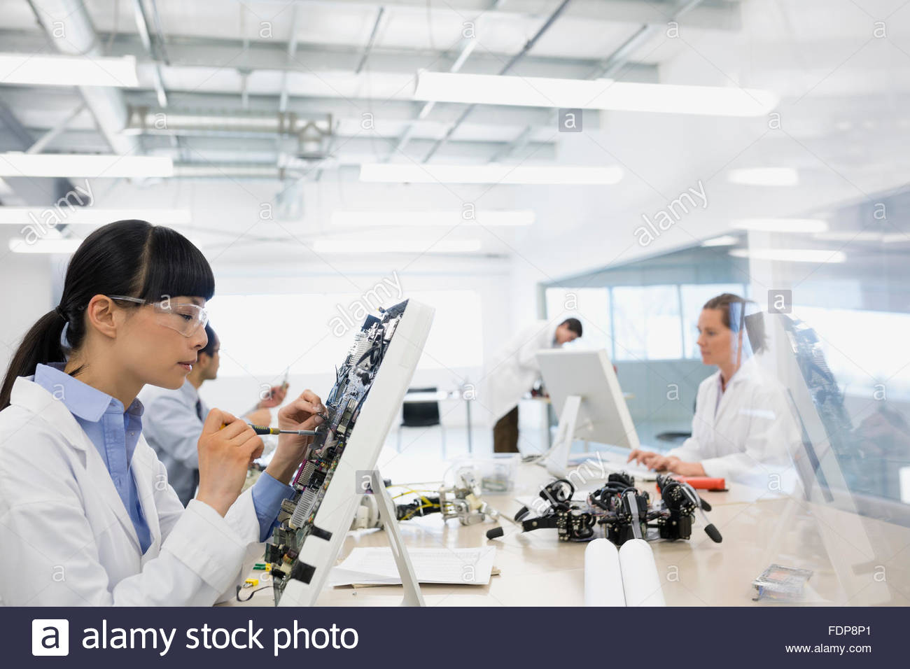 Engineer assembling computer parts Stock Photo