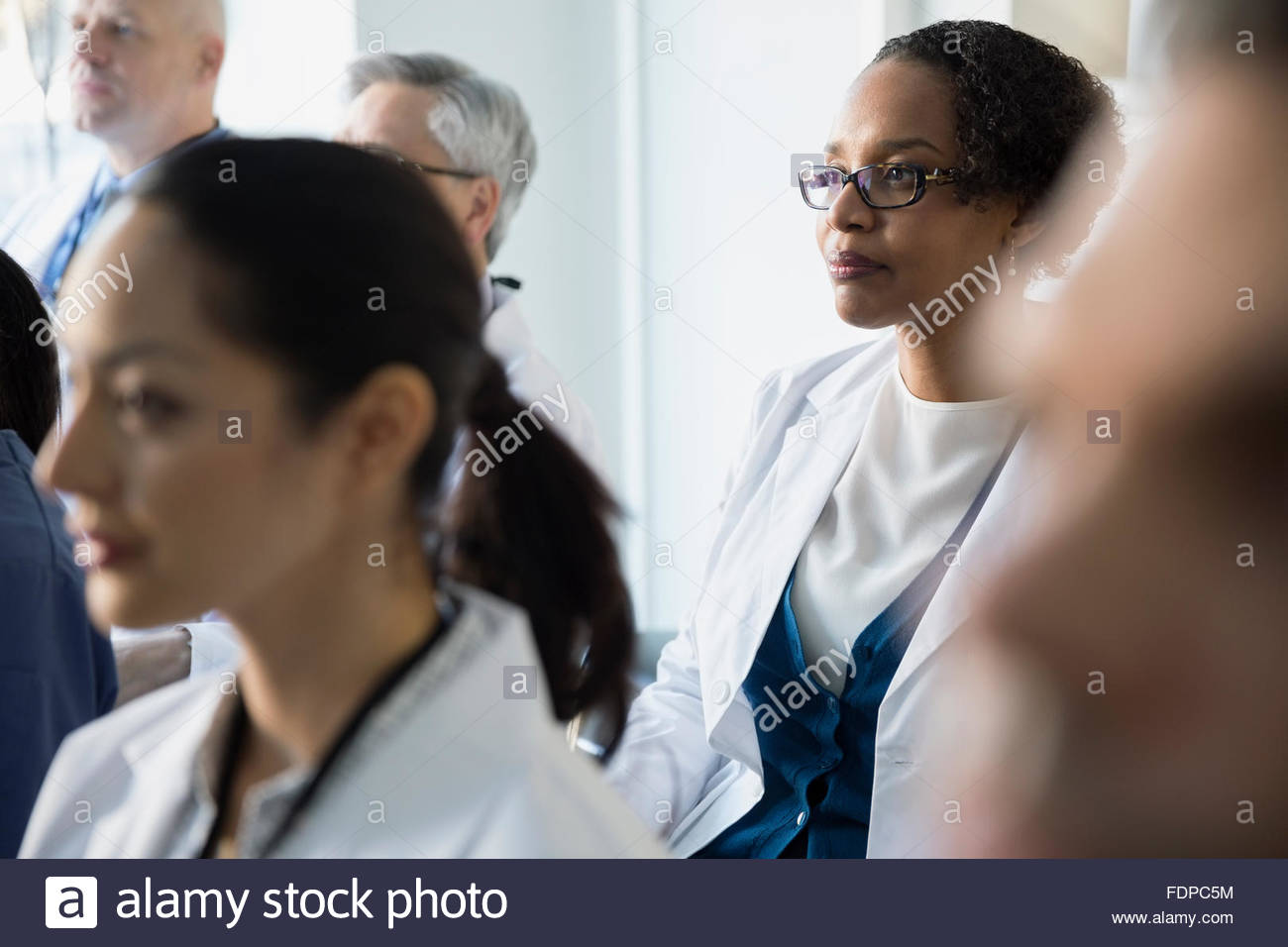 Attentive doctor listening in seminar audience Stock Photo