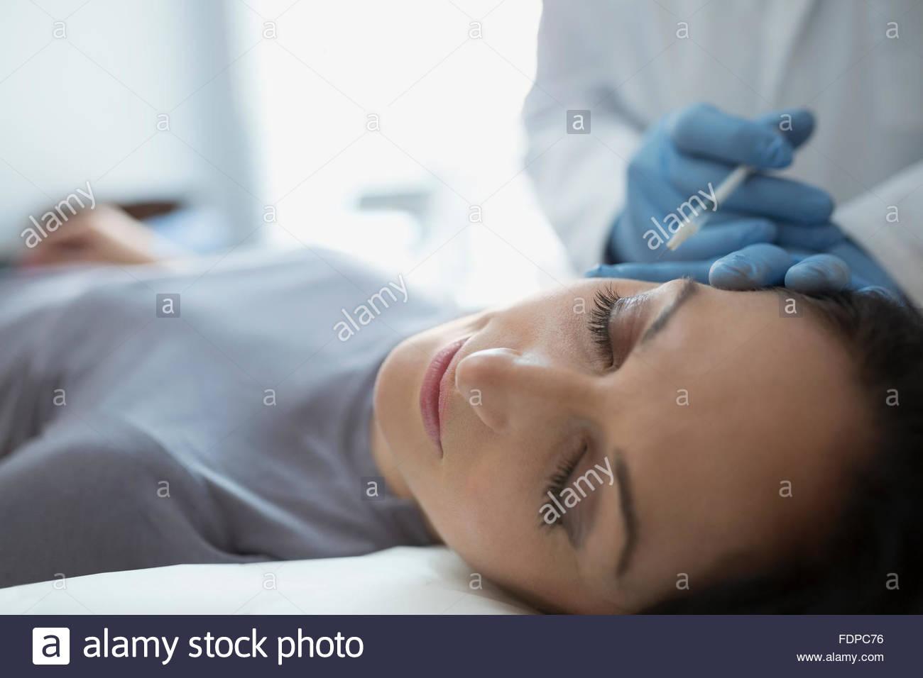 Woman receiving Botox injection - Stock Image