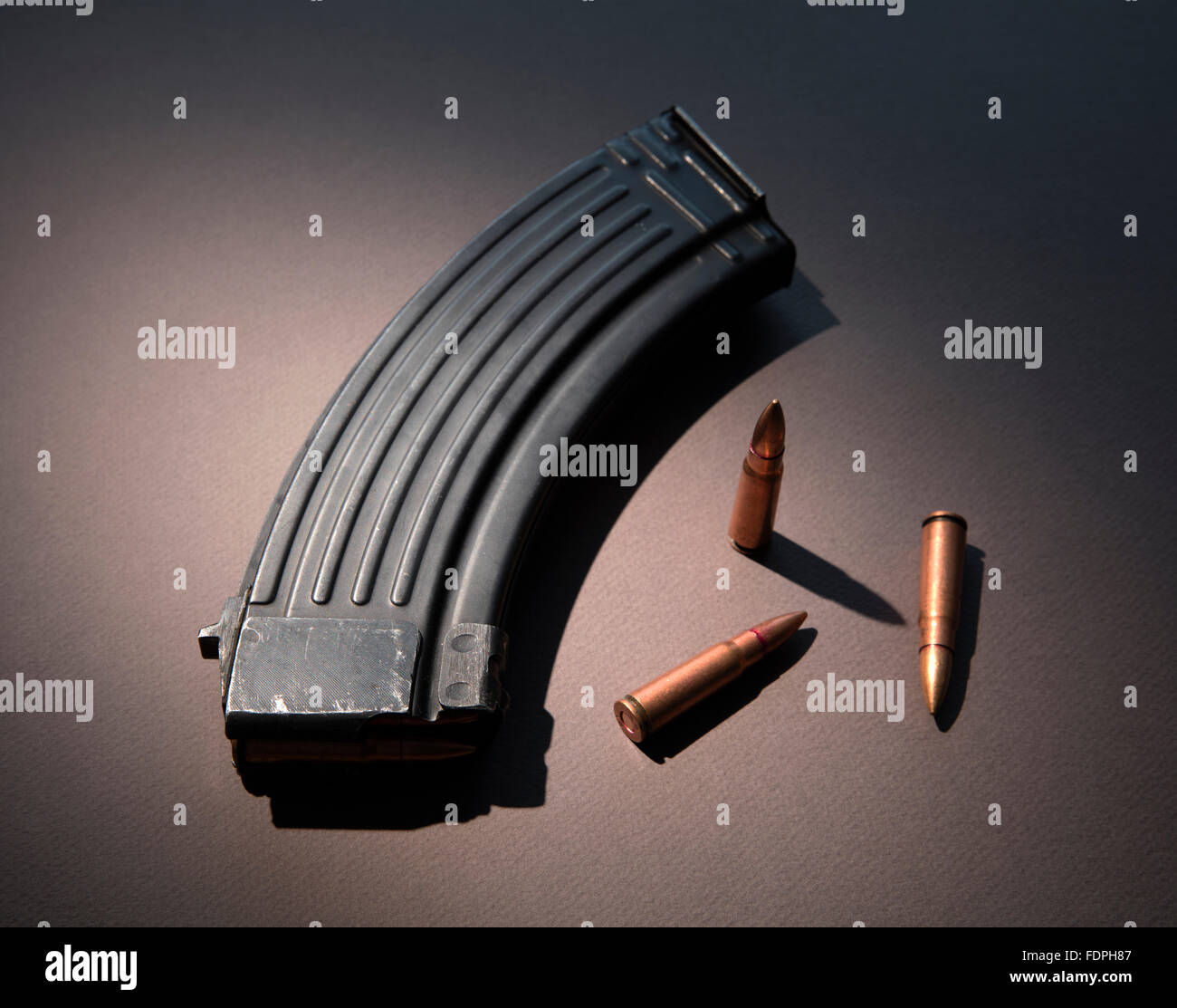 AK-47 high capacity assault rifle magazine with live ammunition of the type gun control advocates hope to ban - Stock Image