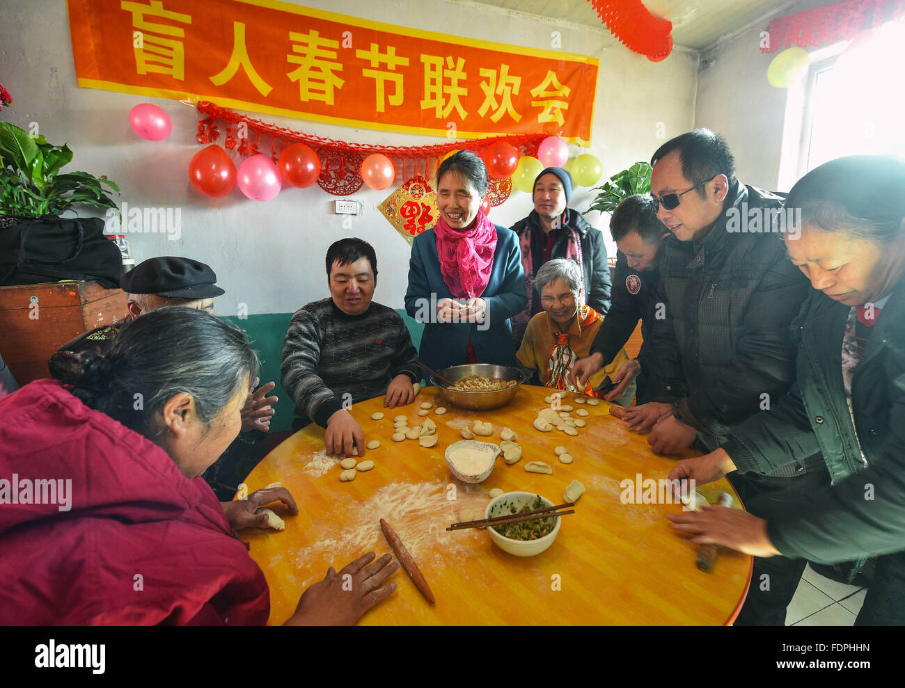 Siping, China's Jilin Province. 1st Feb, 2016. Volunteers and residents make dumplings in Siping, northeast - Stock Image