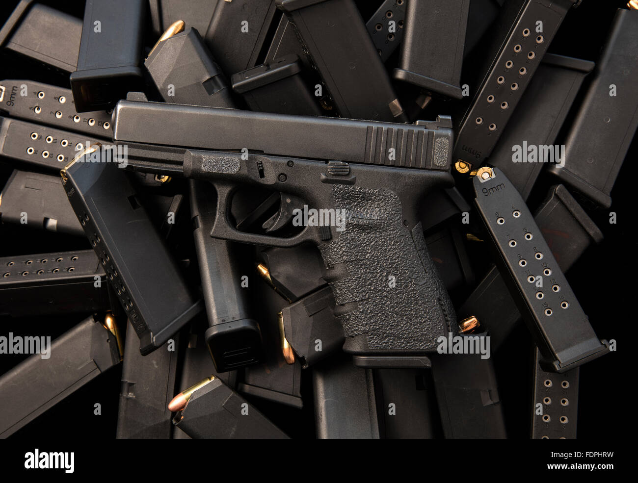 Glock semiautomatic 9mm handgun with high capacity magazines and ammunition - Stock Image