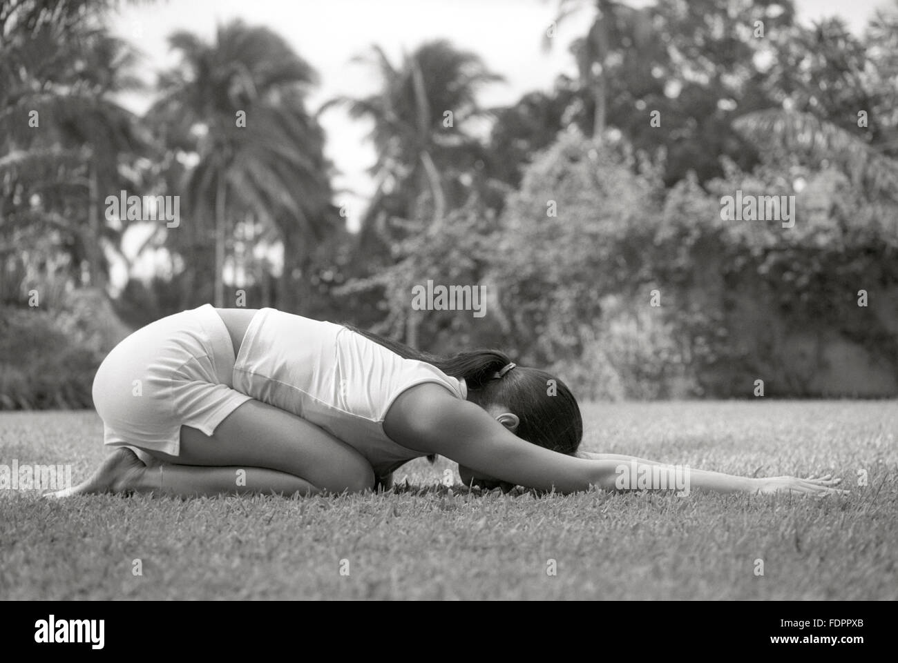 A woman doing a yoga pose outdoors at The Farm at San Benito, Philippines. Stock Photo