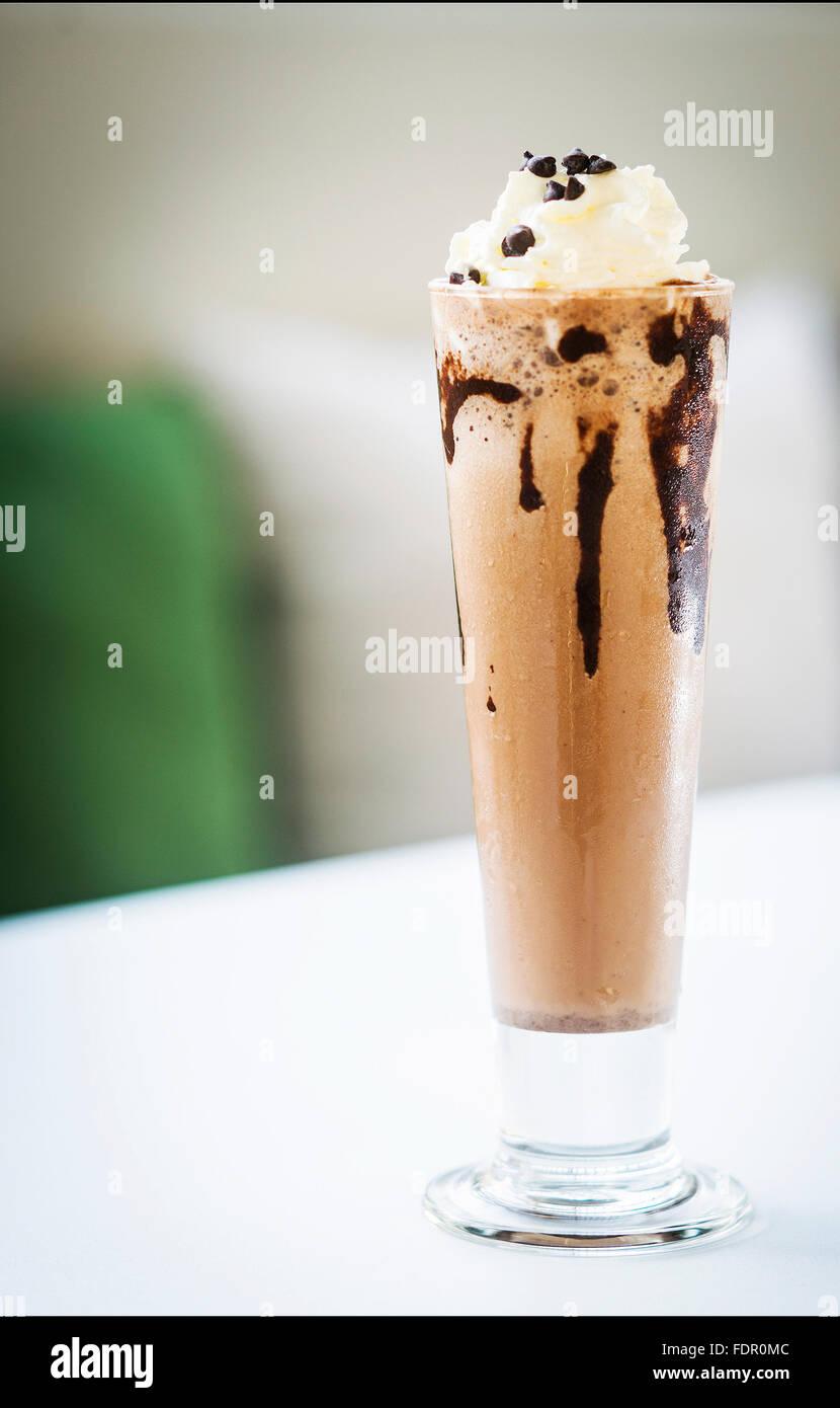 chocolate ice cream milk shake glass with whipped cream - Stock Image