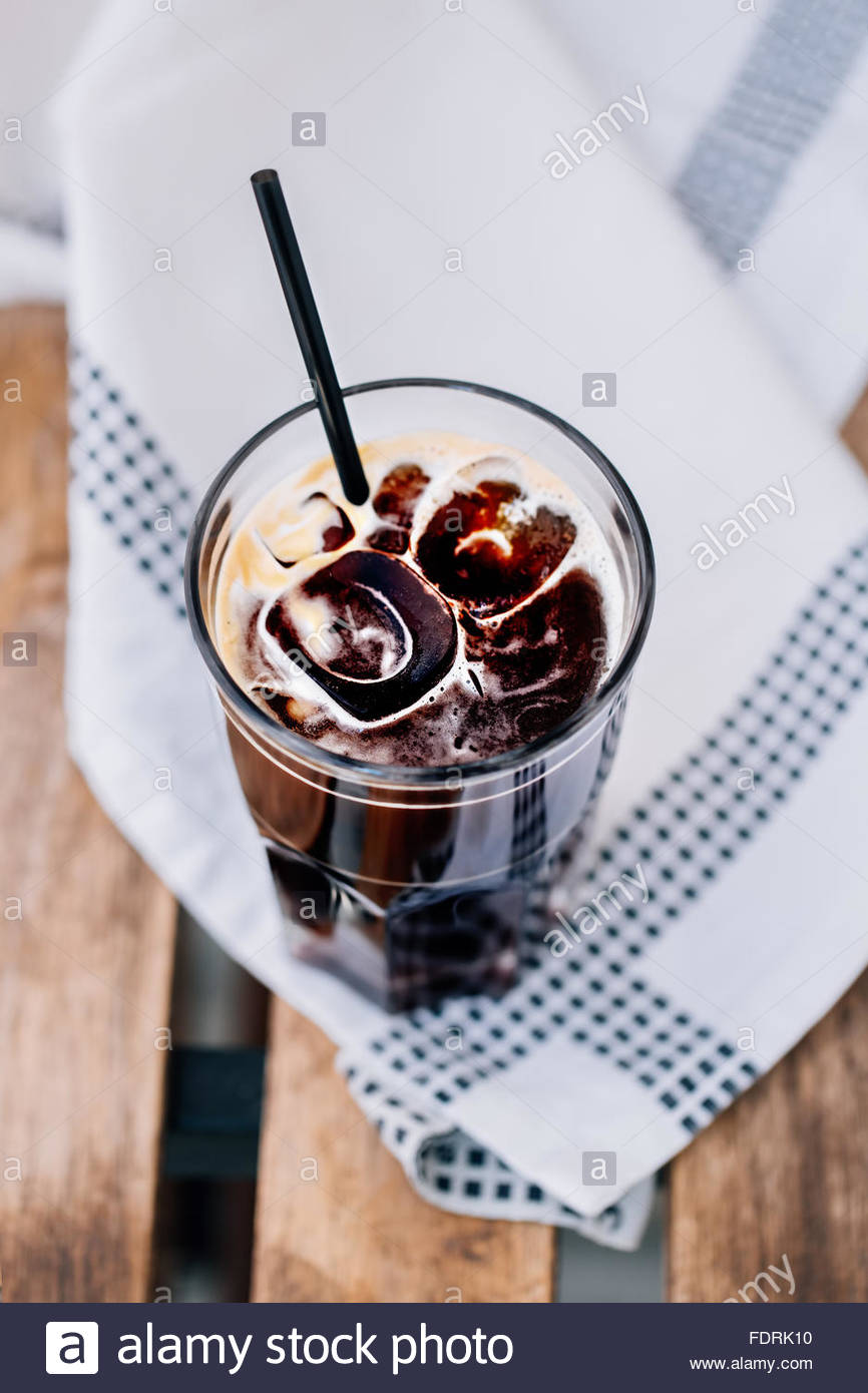 Iced coffee on a white background. Copy space - Stock Image