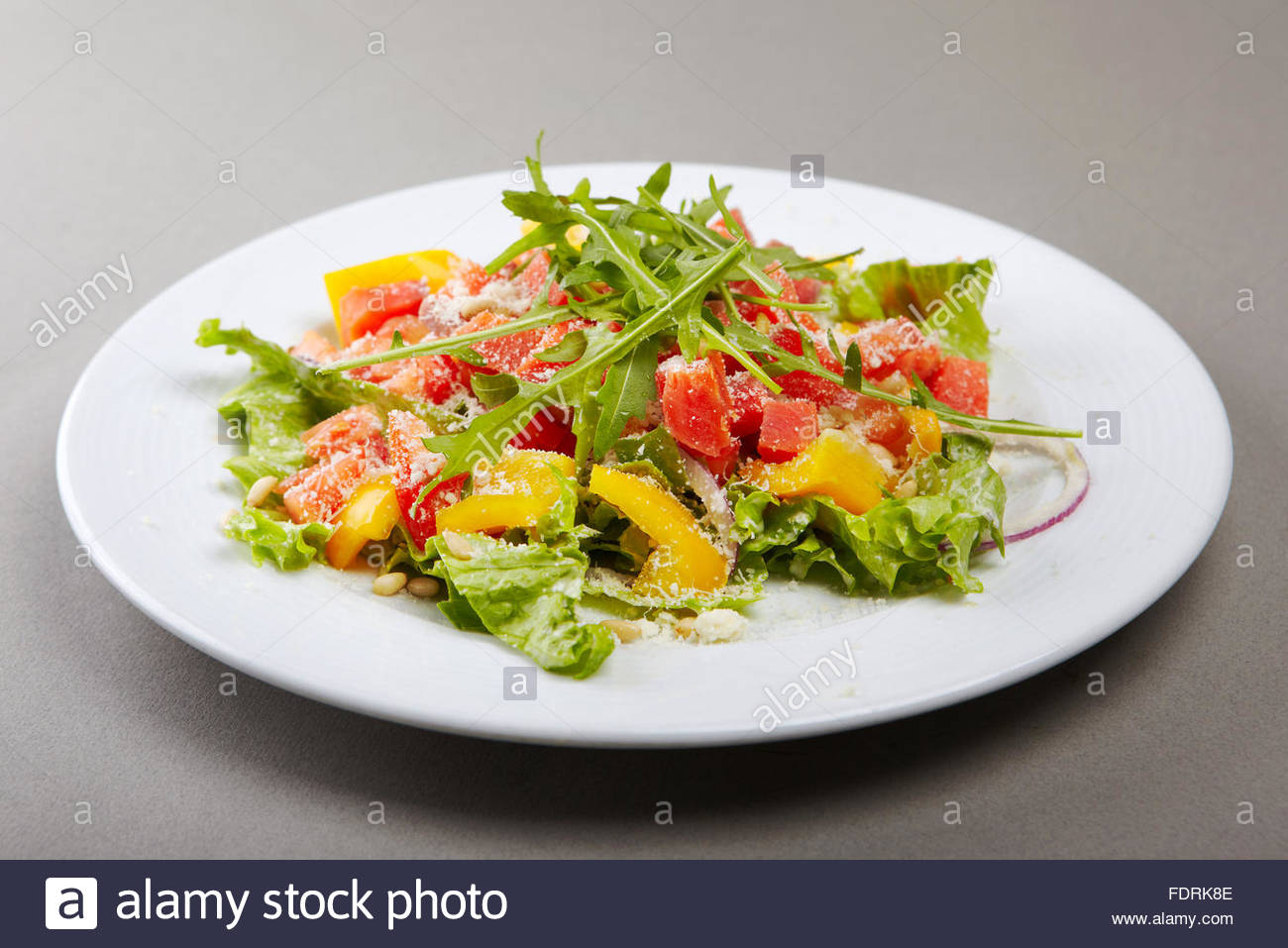 Stylised healthy salad   mixed greens, smoked salmon, tomatoes and paprica. Lots of copyspace - Stock Image