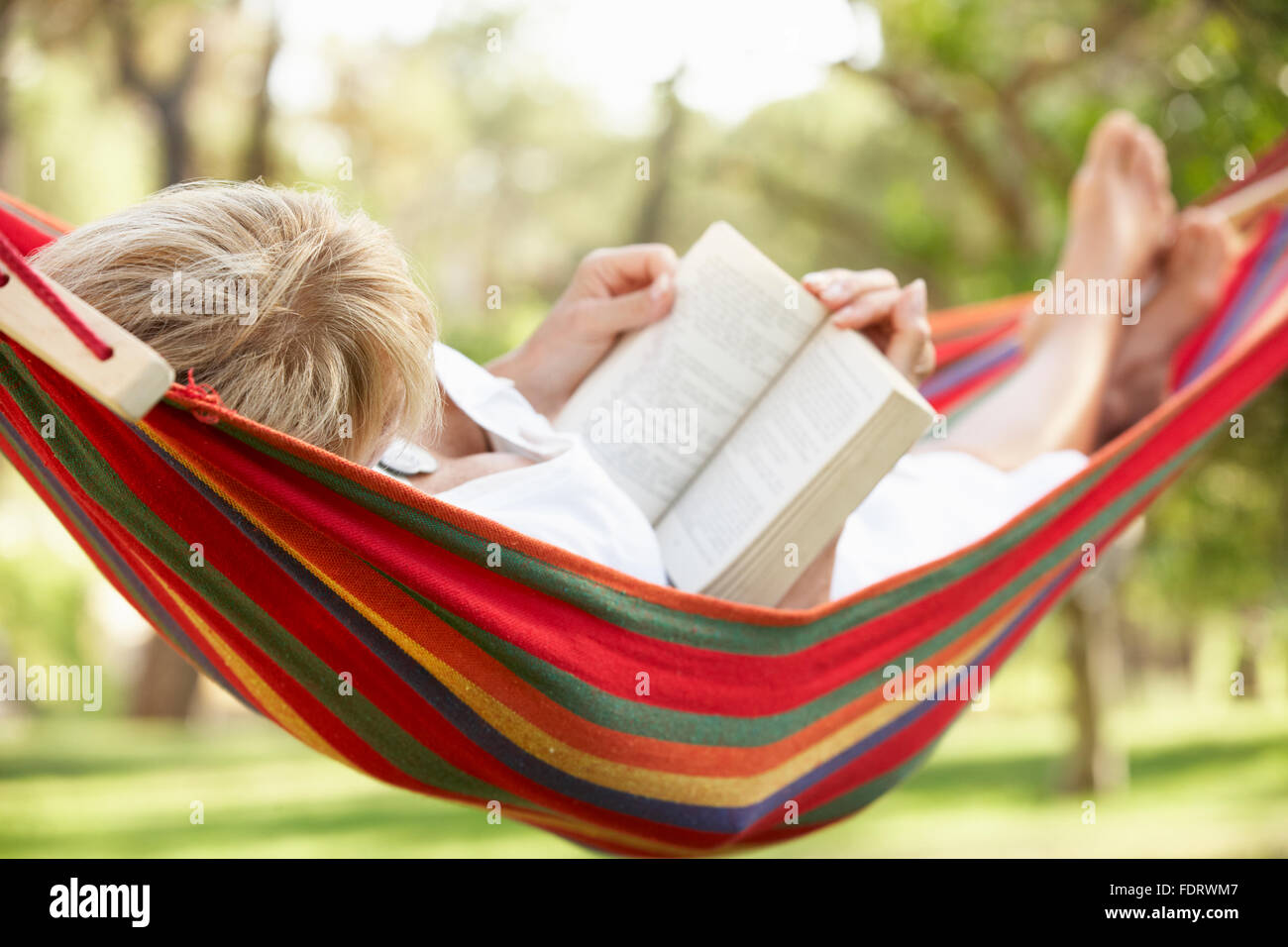 leisure,relaxation,recreation,reading,hammock - Stock Image
