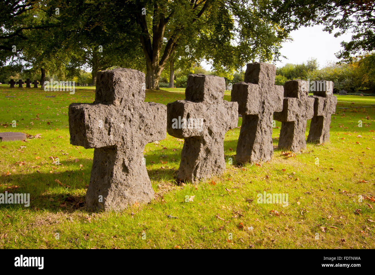 Tombstones and stone crosses at La Cambe German Second World War military cemetery, Lower Normandy, France - Stock Image