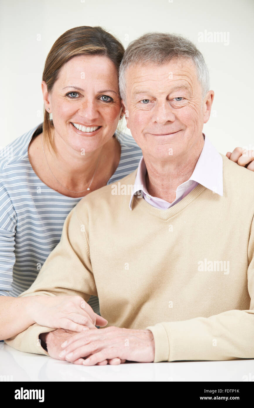 Portrait Of Senior Man With Adult Daughter - Stock Image