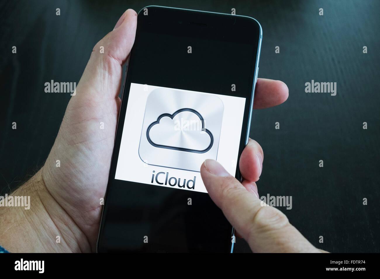Apple iCloud online cloud storage logo on screen of iPhone 6 Plus smart phone - Stock Image