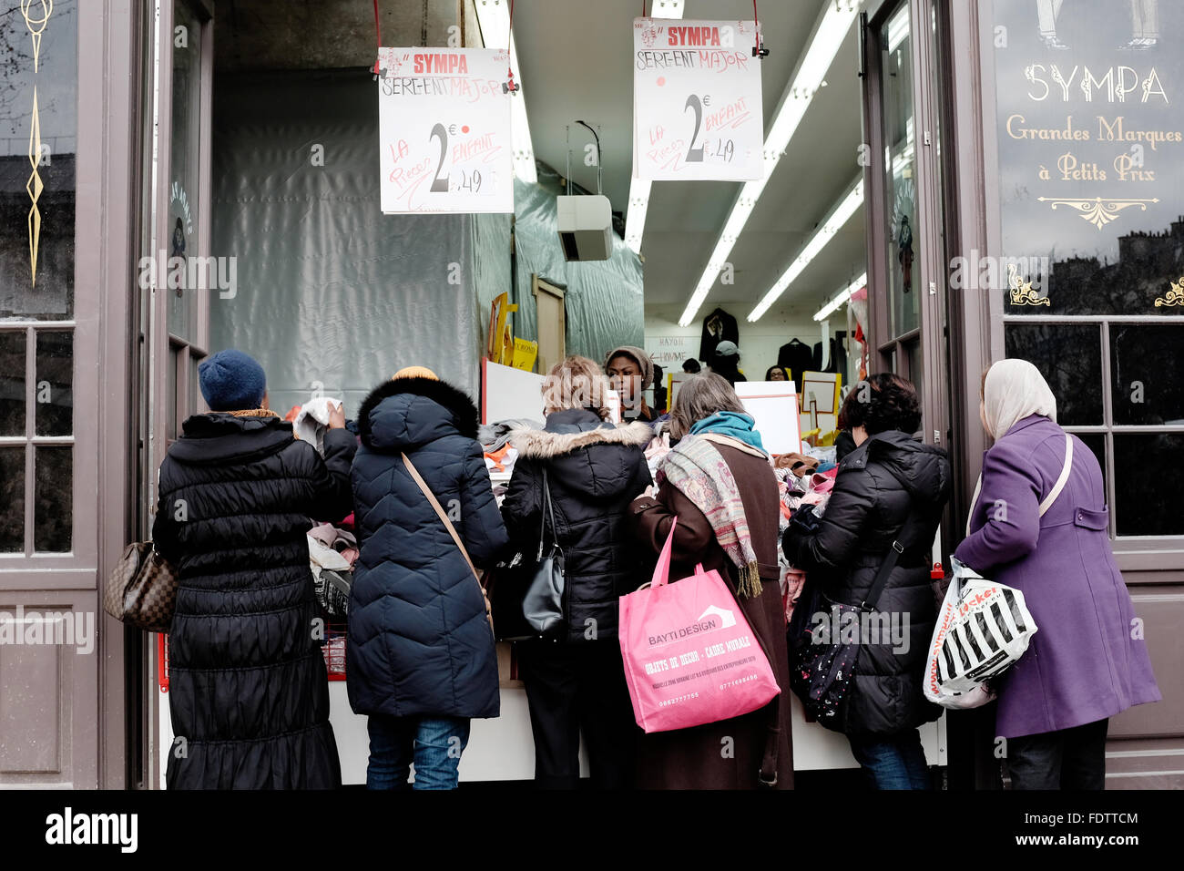 Women buying cut-price Clothes at Sympa discount shop, on the Boulevard Barbes, Paris France - Stock Image