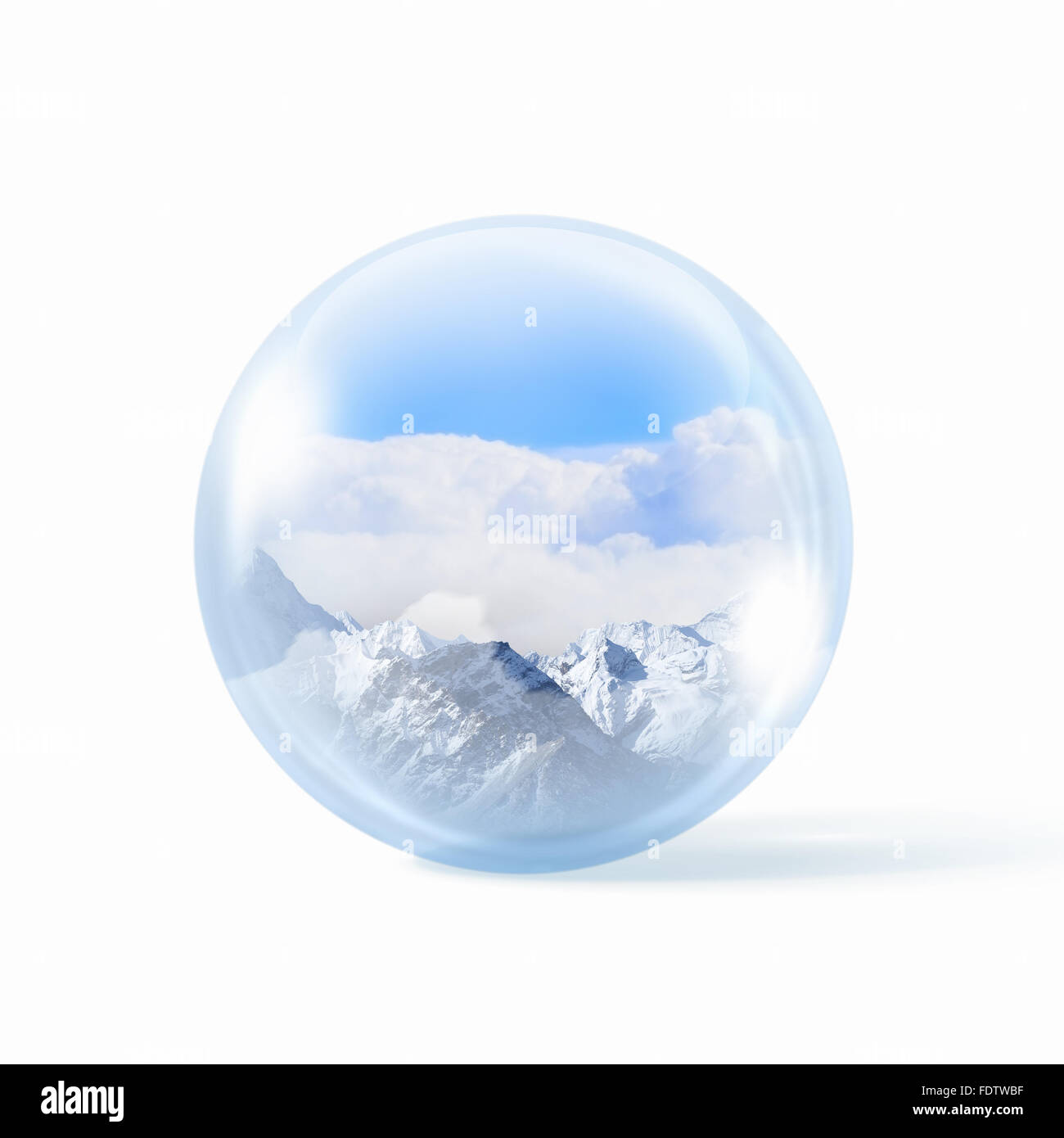 A glass transparent ball with snow high mountains inside it. - Stock Image