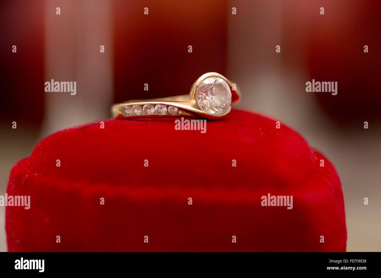 Engagement ring on the red box. - Stock Image