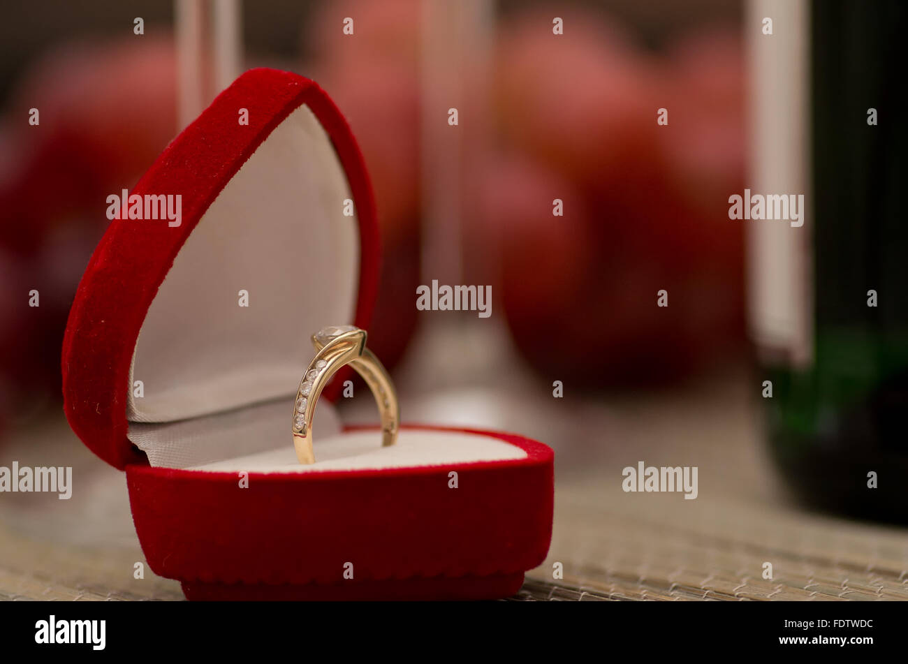 An engagement ring in a red box. - Stock Image