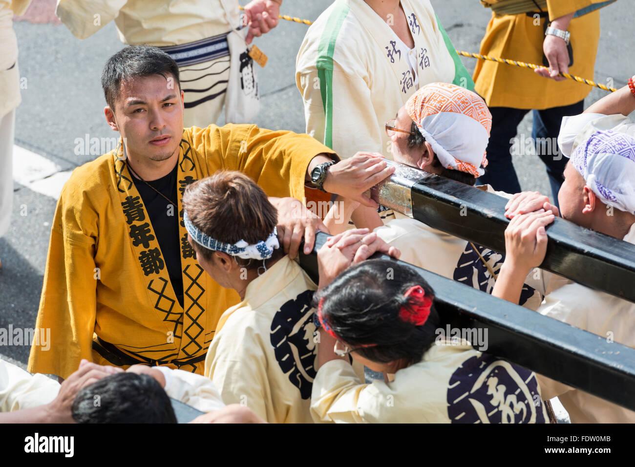 Mikoshi carried at the Grand Festival of Hanazono Shrine, Shinjuku, Tokyo, Japan - Stock Image