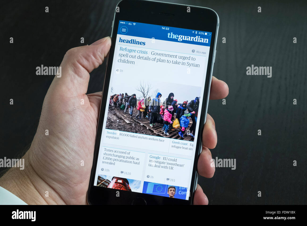 The Guardian news app on iPhone 6 Plus smart phone - Stock Image