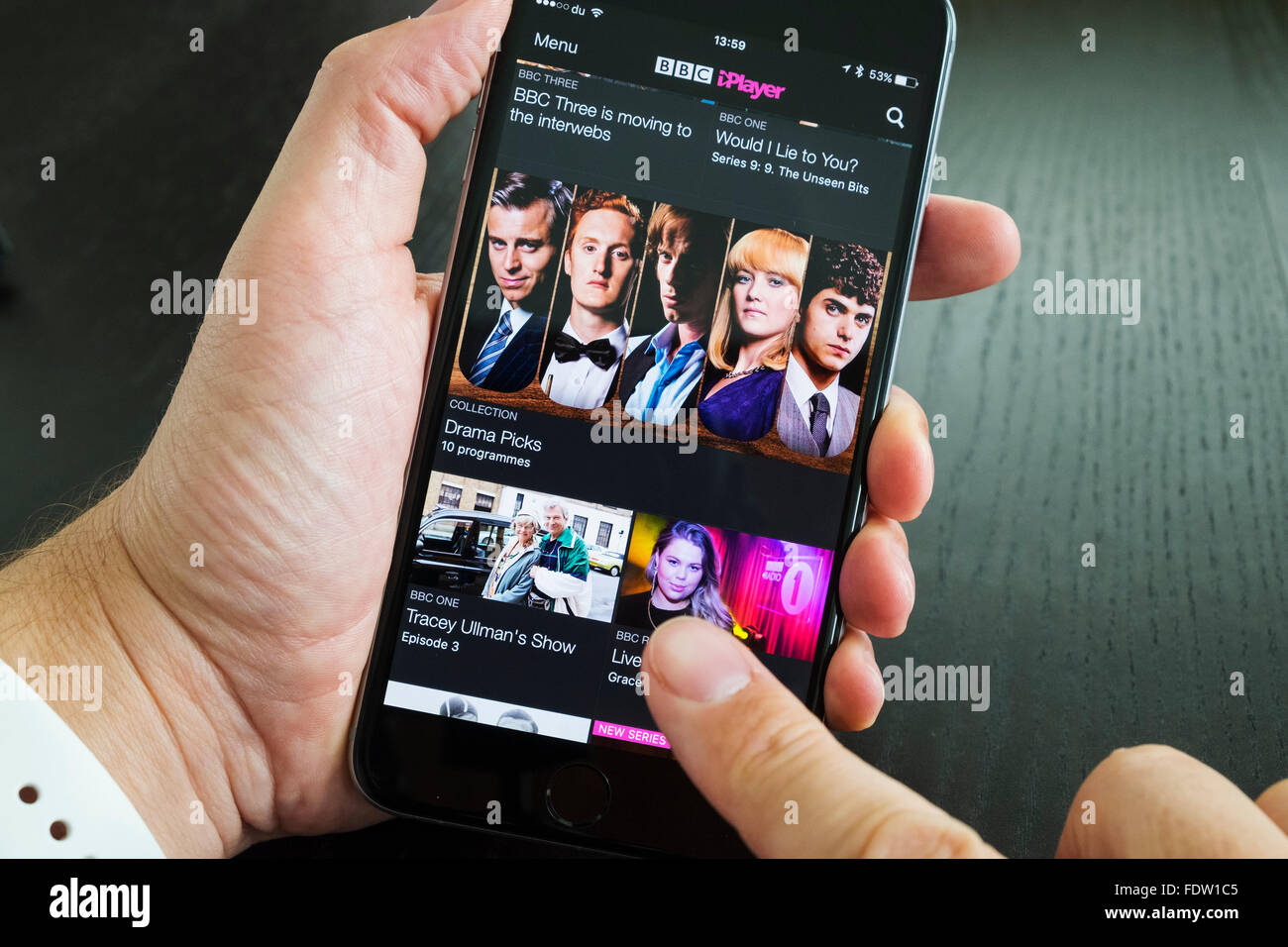 Home screen of BBC iPlayer catchup TV streaming service on iPhone 6 Plus smart phone - Stock Image