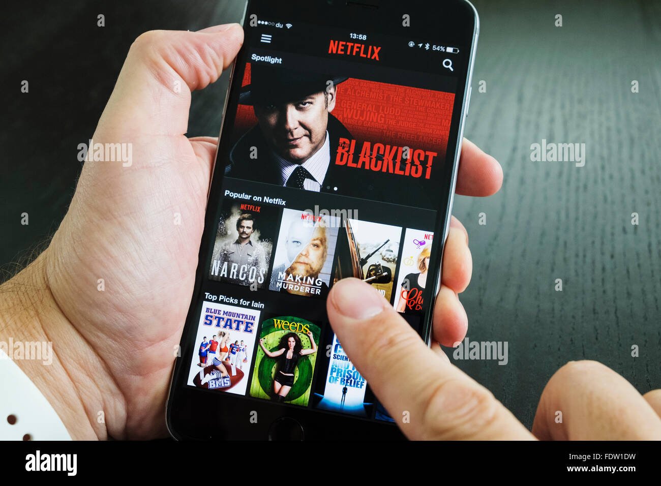 Homepage of Netflix on-demand Movie and TV streaming service app on iPhone 6 plus smart phone - Stock Image