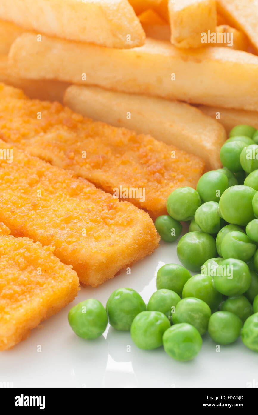 Fish fingers chips and peas a popular children's meal Stock Photo