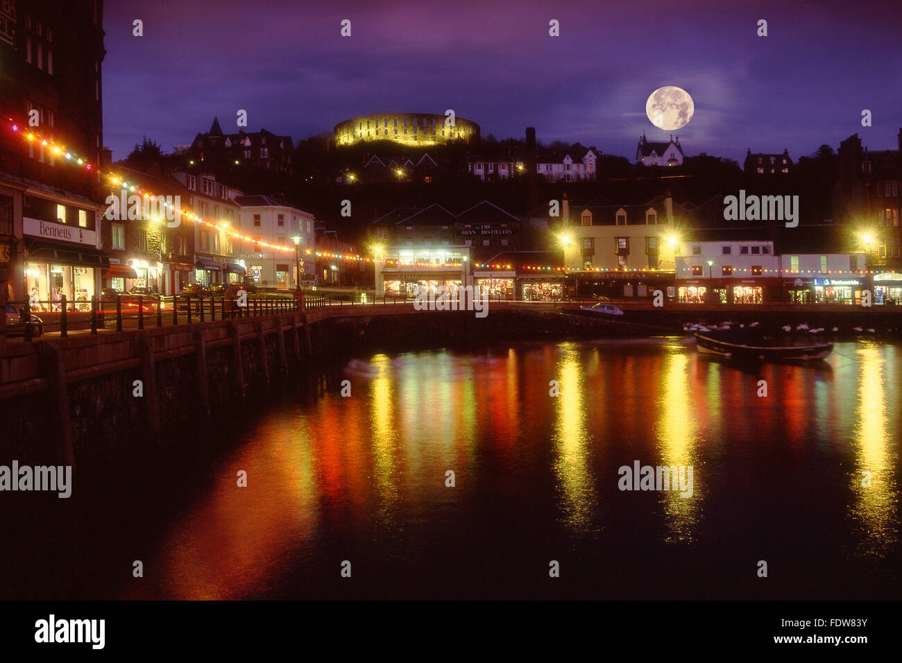 Christmas in Oban with McCaigs tower as seen from the north pier.Oban,Argyll,scotland.2008 Stock Photo