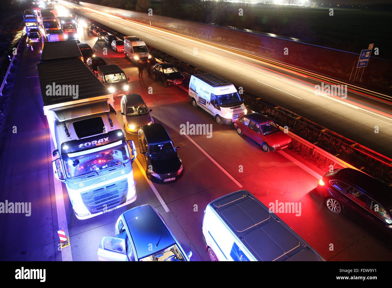 Trucks and cars queue during a traffic jam on the A9 motorway near Wiedemar in Berlin, Germany, 25 January 2016. Stock Photo