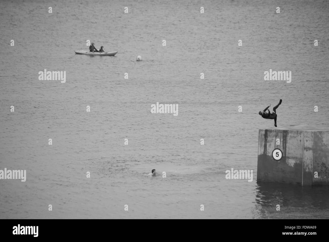 Somersaulting from Cullercoats pier Stock Photo
