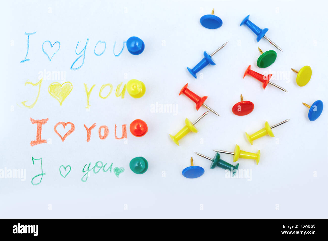 Love you letter with colorful push pins - Stock Image