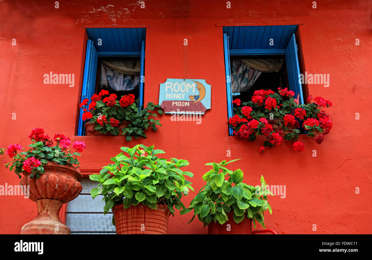 Crete, in the Old Town of Chania, small pension, Room Honey Moon, red house wall with floral decoration - Stock Image