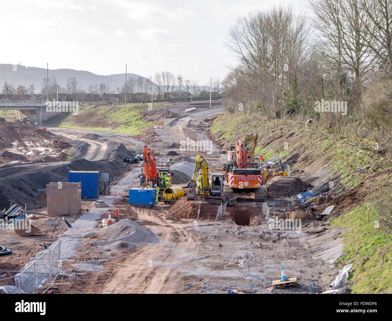 Diggers moving soil to make way for a new road layout - Stock Image