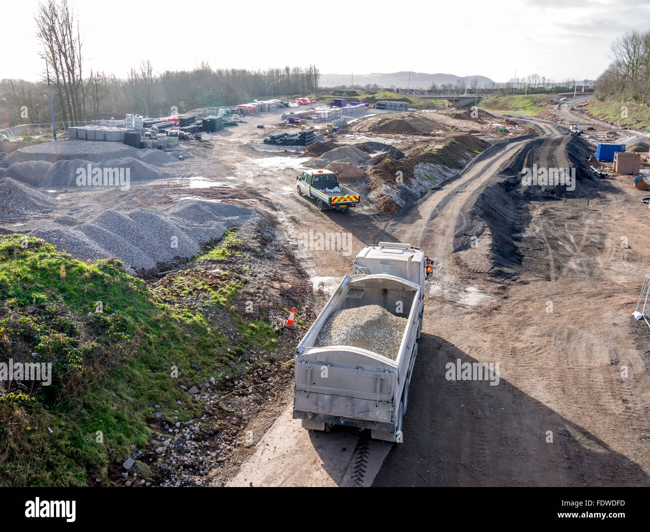 Lorry arriving on site to unload stone for a new road layout - Stock Image