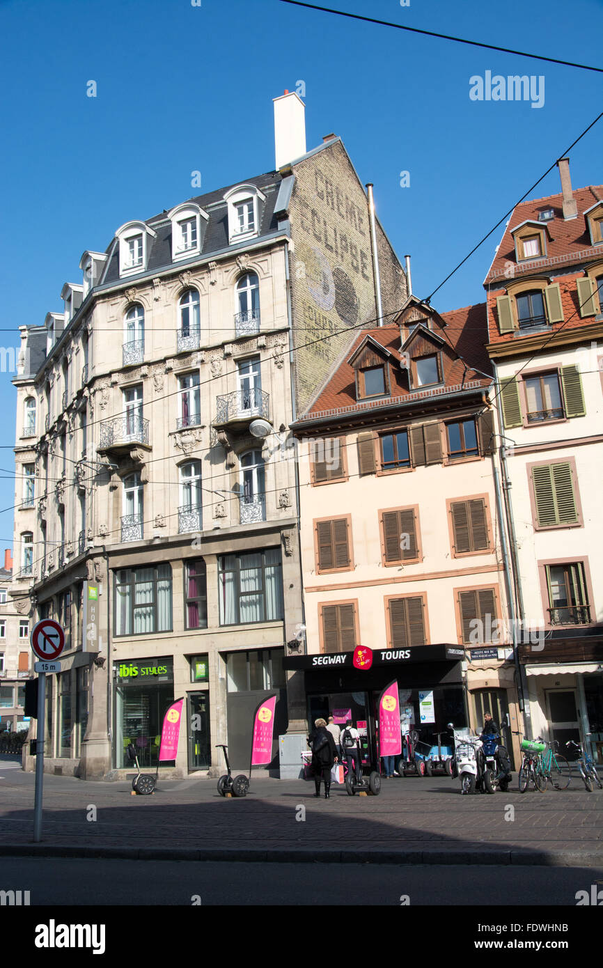 An IBIS Styles hotel and a Segway tour office in Petite Rue du Vieux Marché aux Vins Strasbourg France - Stock Image