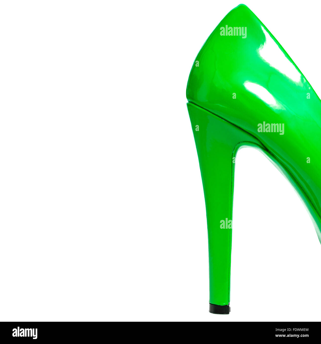 Back of green shiny patent leather high heels isolated on white background.  Model Release: No.  Property release: - Stock Image