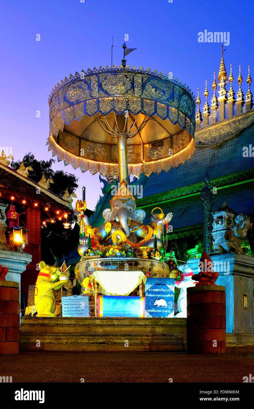 Silver Ganesha beneath a silver chhatra in Wat Sri Suphan, Chiang Mai, Thailand - Stock Image
