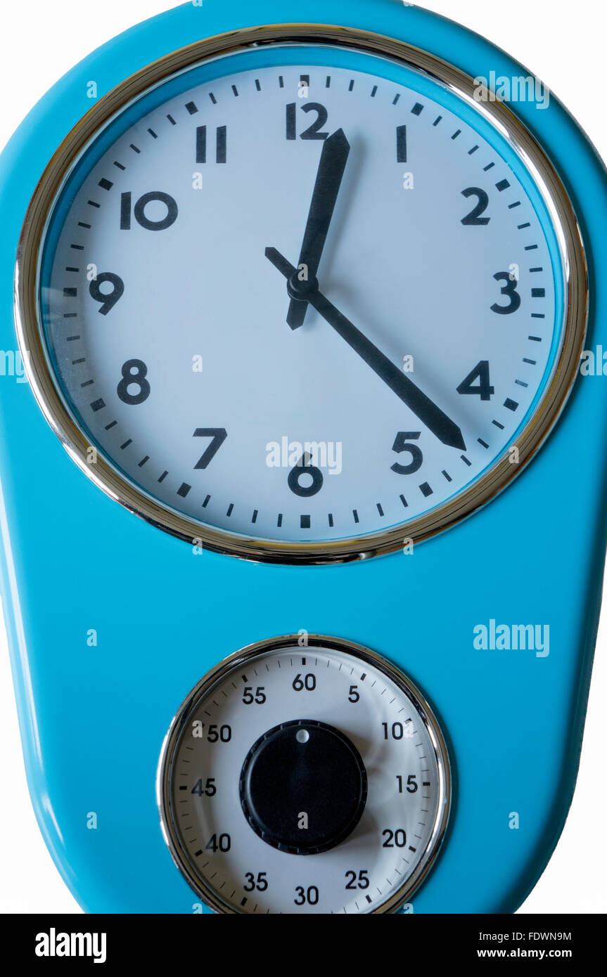 Blue kitchen clock and egg timer isolated on a white background. - Stock Image