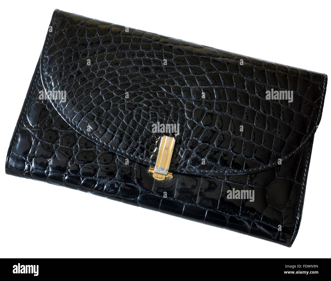 Black crocodile skin clutch bag isolated on white background.  Model Release: No.  Property Release: No. - Stock Image