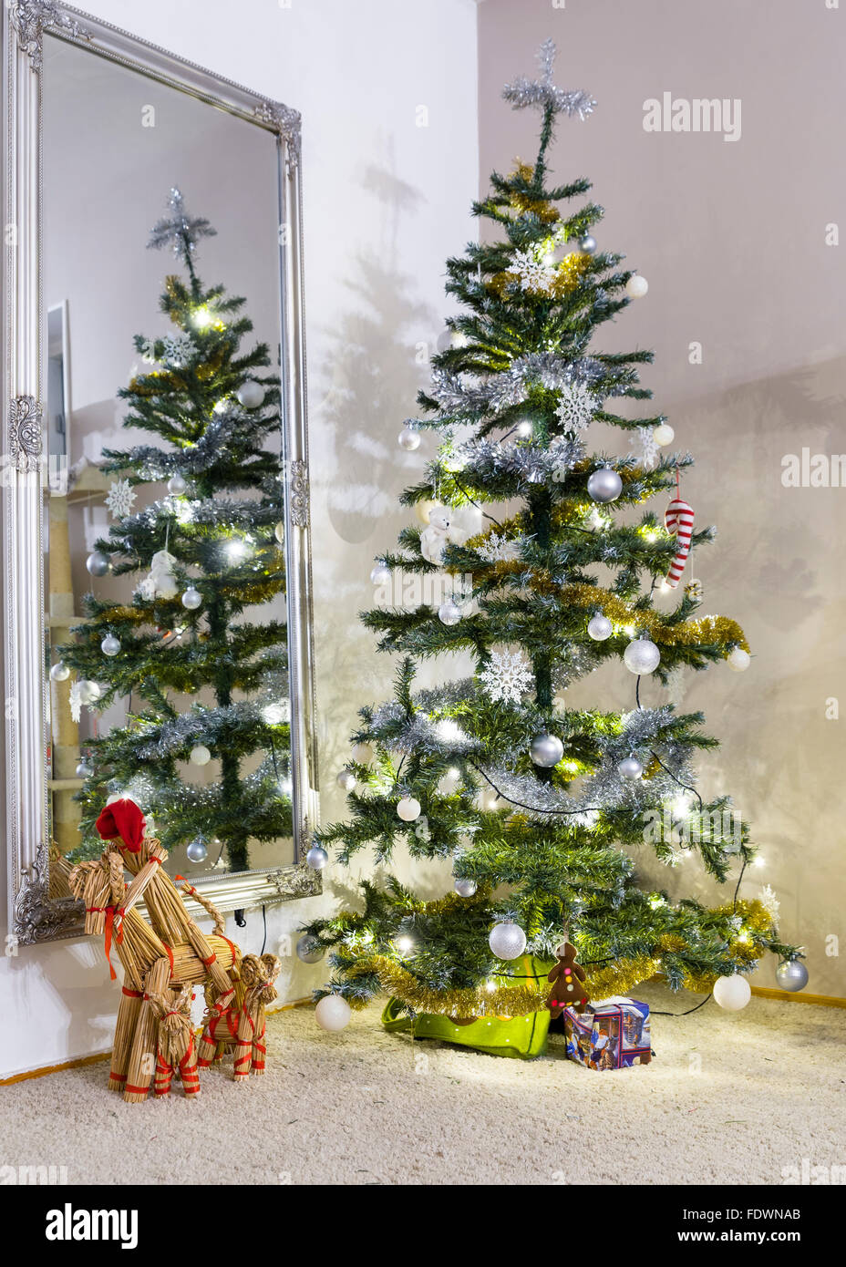 Beautifully decorated Christmas tree and traditional swedish straw Yule goat.  Model Release: No.  Property Release: - Stock Image