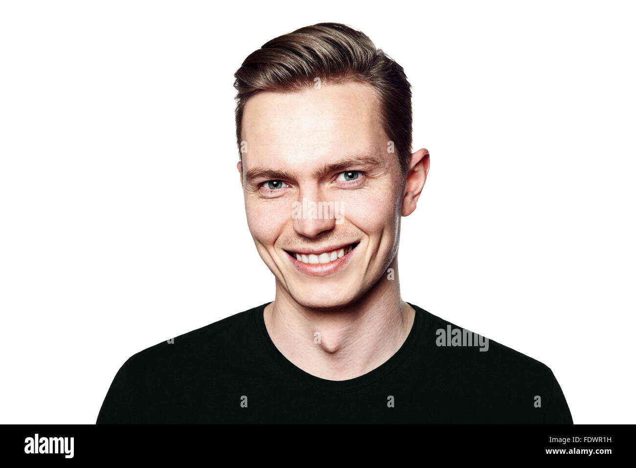 Studio shot of young man smiling to camera. Isolated on white background. Horizontal format, he is looking to the - Stock Image