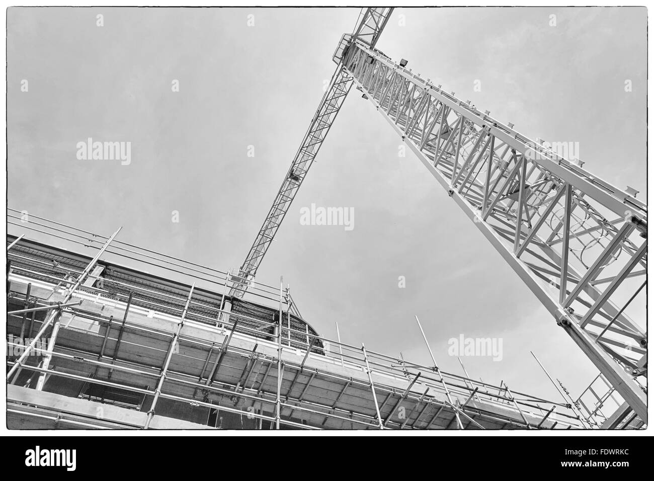 A construction site with concrete slabs built held together with scaffolding - Stock Image