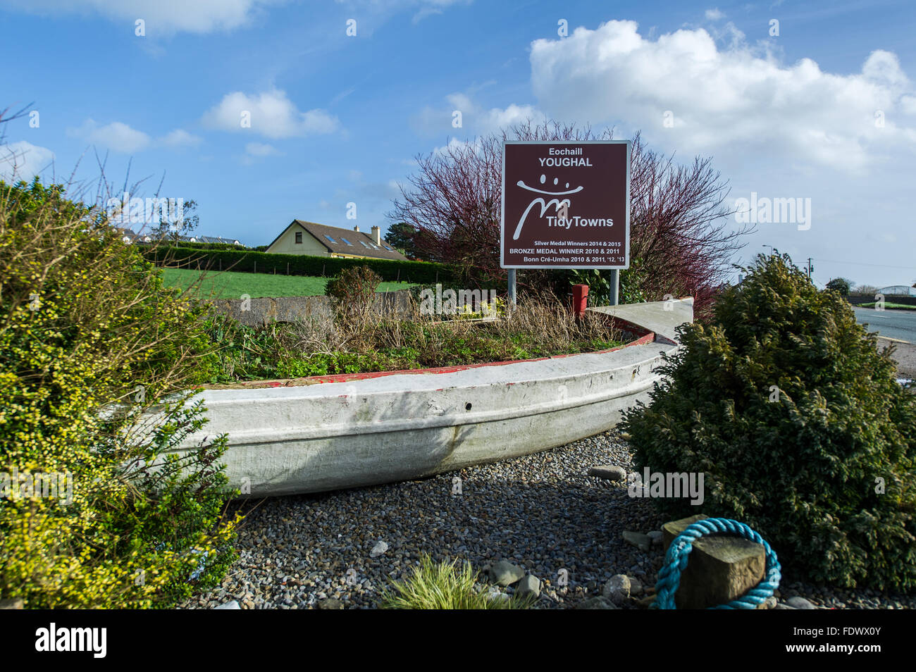 The Youghal Tidy Towns sign with a boat, just outside Youghal, Co Cork, Ireland - Stock Image