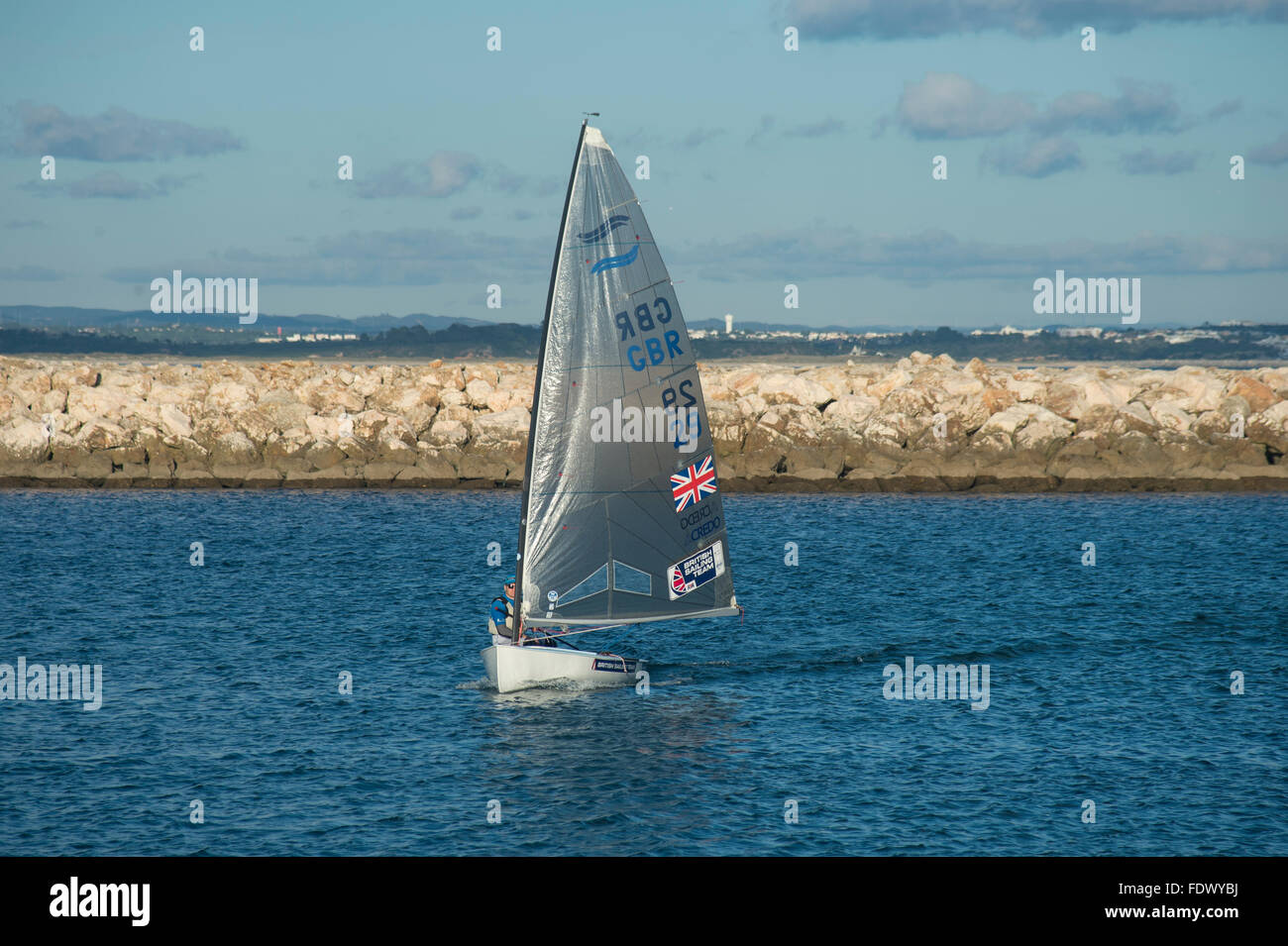 Peter McCoy sailing the International Finn dinghy - Stock Image