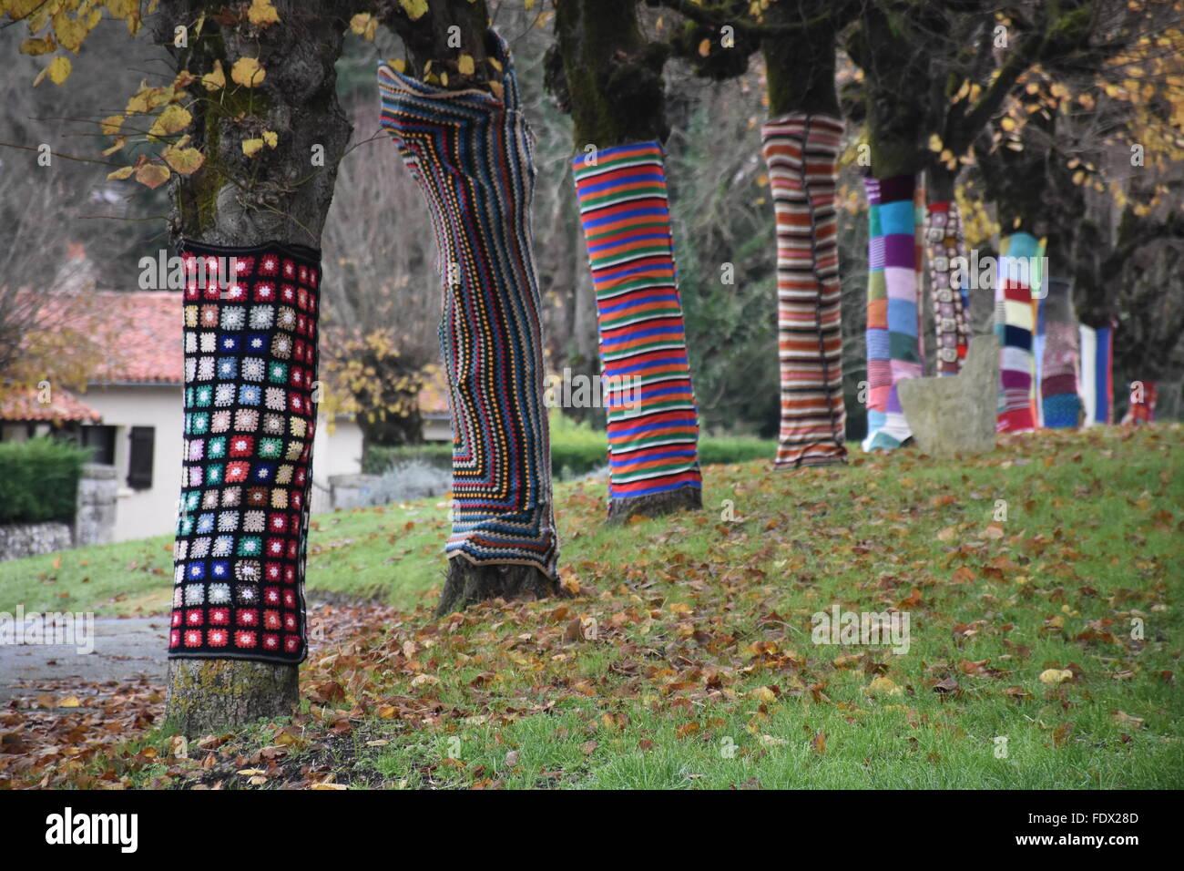 Decorated trees beside the Eglise de Charroux (Charroux church) Vienne (86) France - Stock Image