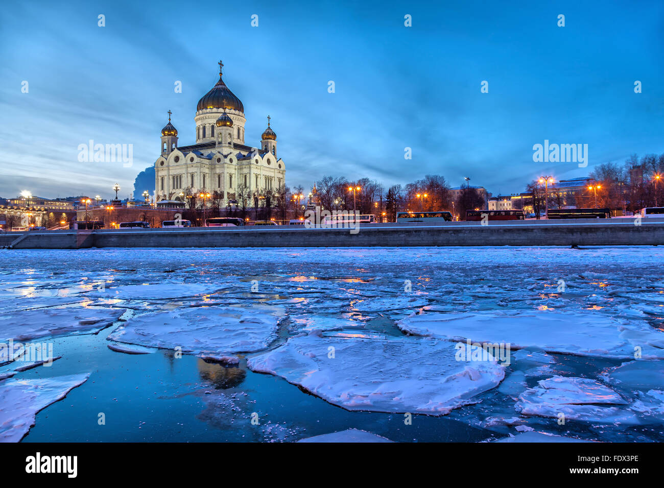 Floe on the Moscow River with Christ the Savior Cathedral on background on a winter evening, Moscow, Russia - Stock Image
